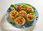 Stuffed artichoke bottoms with tomatoes & pine nuts