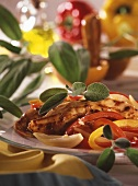 Grilled chicken breast with peppers and sage leaves