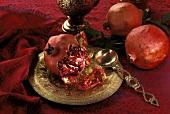 A Broken Pomegranate on a Fancy Plate
