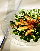 Spinach Salad Topped with Chicken Fingers