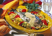 Dentex with mustard sauce and courgettes & tomatoes