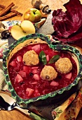 Red cabbage and apple stew with cinnamon dumplings