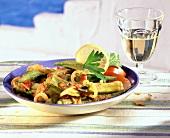 Okra with tomatoes, onions, parsley & lemon slice