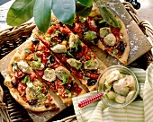 Pizza ai carciofi (Artichoke pizza with olives and oregano)