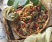 Whole artichoke pizza with tomatoes, olives & fresh oregano
