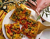 Olive quiche with red and yellow peppers