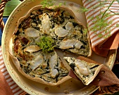 Cod quiche with dill mousse, dill flowers, on piece raised