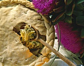 Anchovy and chicory tart with capers and woven edge