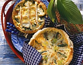 Spinach quiche with monkfish; salmon-asparagus quiche with dill