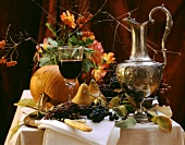 Autumn still life with grapes, pears, pumpkin & red wine