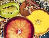Slices of orange, kiwi fruit, dried fruits & cereal flakes