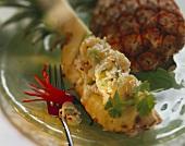 Pineapple Rice Salad on a Slice of Pineapple