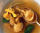 Won tons (pastry parcels) in broth with parsley & flower
