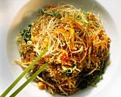 Glass noodles with vegetables & sesame seeds, green chopsticks