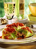 Cabbage roulades with grits and tomatoes