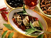 Aubergine roulades on tomato sauce with fresh sage