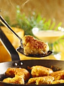 Chicken wing in batter with coconut sauce (steaming piece)