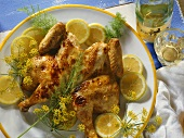 Barbecued chicken with herbs and lemon slices