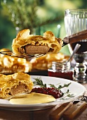 Venison medallions in puff pastry with cranberries