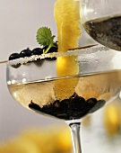 Summerwine cocktail with blackcurrants & Prosecco