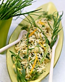 Spaghetti with herb butter and herb leaves