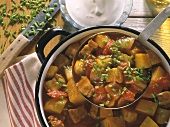 Hungarian potato goulash in pot and on ladle