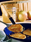 Potato pancake in the pan and on spatula