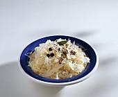Sauerkraut with juniper berries, caraway & bay on plate