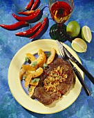 Caribbean beef steak with onions and apricot salad