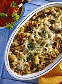Pasta & vegetable bake in baking dish & tomato sauce
