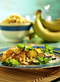 Curried rice with bananas, courgettes & flaked almonds