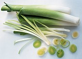 Several leeks, whole, cut open and in rings