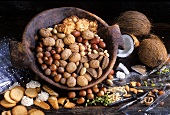 Still life with various nuts in wooden bowl & nut biscuits