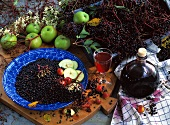 Still life with elderberries and elderberry juice