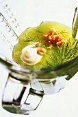 Chilled cucumber soup with dill, shrimps in glass measuring jug