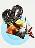 Ingredients for salmon pasta: wild salmon, black pasta, lemon