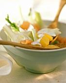 Fennel salad with salmon & orange segments in white bowl