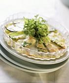 Potato and mangetout gratin in round glass baking dish