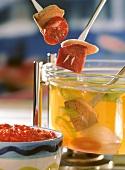 Bollito misto fondue, skewers over fondue pot of broth
