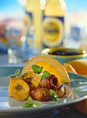 Caribbean style fondue with pork fillet, bananas