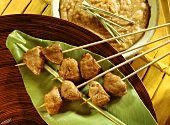 Fondue with satay kebabs on banana leaf & peanut dip