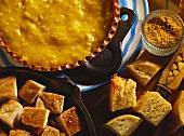 Chicken curry fondue (curried cheese sauce, chicken, bread)
