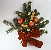 Christmas decoration made of fir branches, apples, gold nuts