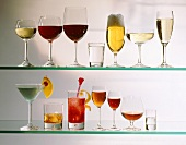 Various types of glasses filled with alcoholic drinks