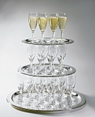 Champagne glasses on trays, three deep