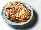 Egg waffle hearts with icing sugar on plate