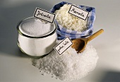 Iodine salt in jar, sea salt im bag and coarse salt
