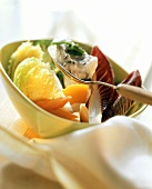 Steamed vegetables with herb & garlic quark on spoon