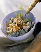 Buckwheat noodles with chard & salmon in white bowl