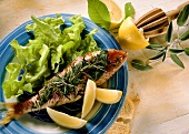 Barbecued red mullet with sage, rosemary, lemons and lettuce